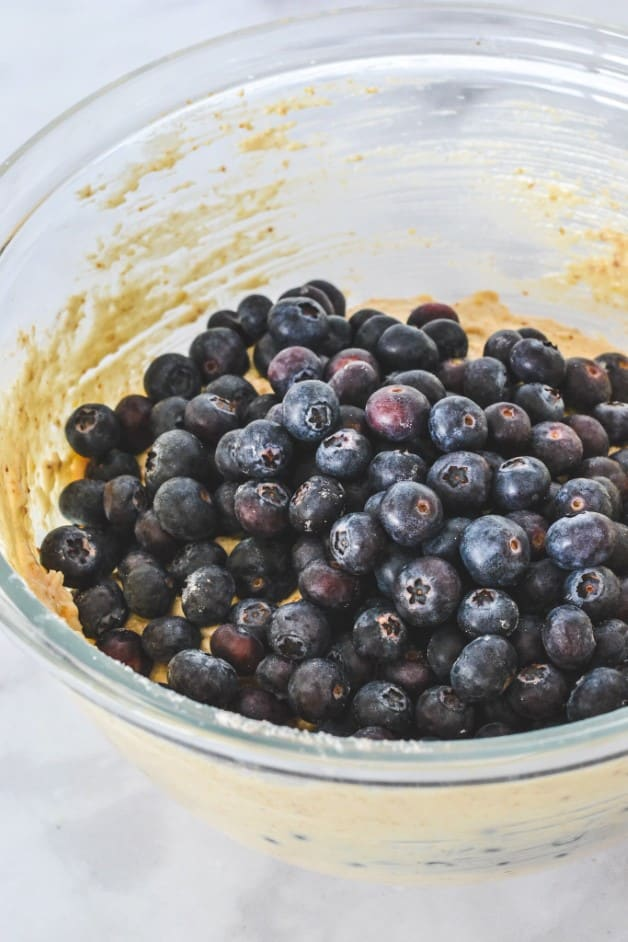 blueberries-in-muffin-batter-in-glass-bowl