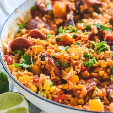 red-rice-in-white-pan-with-chorizo-and-herbs
