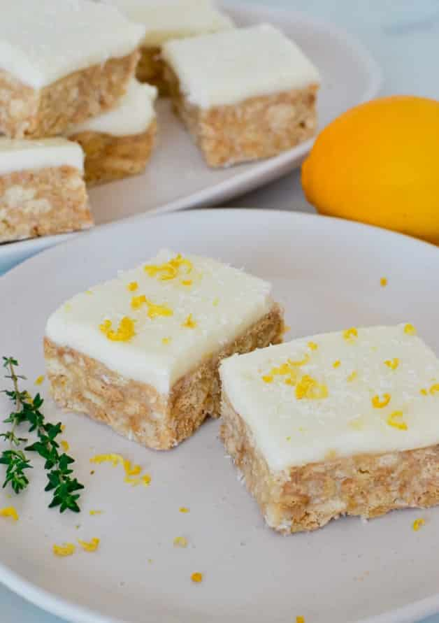 two pieces of slice on white plate with lemon zest