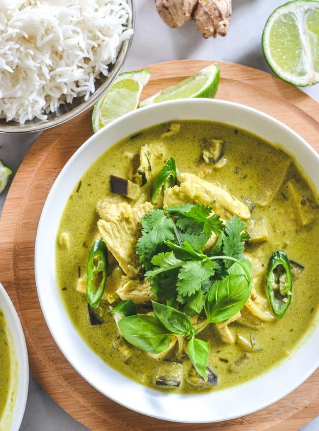 top-view-of-thai-green-curry-in-white-bowl-with-lime-wedges