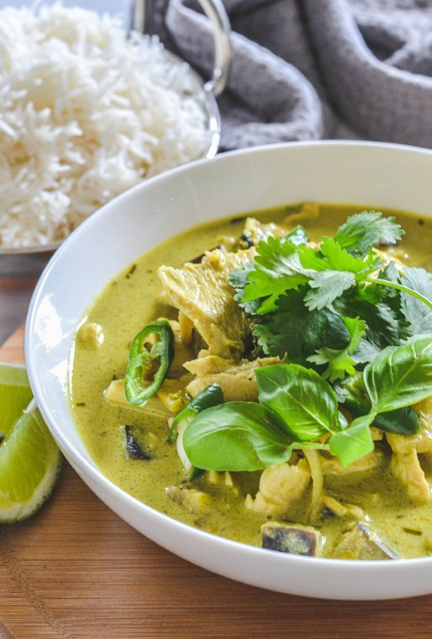 green-curry-in-white-bowl-with-chicken-herbs-and-bowl-of-rice