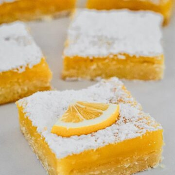 yellow-lemon-curd-slice-cut-into-squares-on-white-board