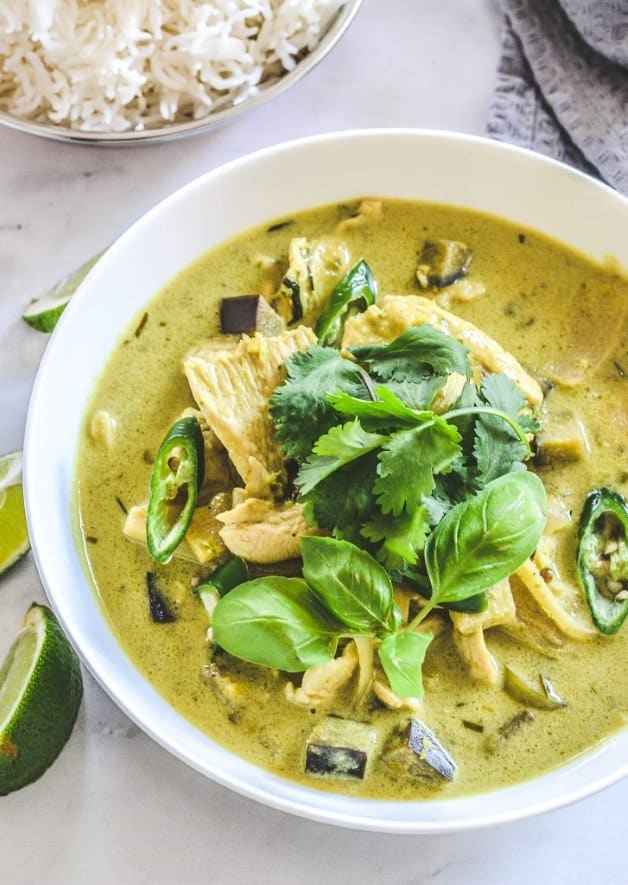 green-curry-in-white-bowl-with-chicken-and-herbs