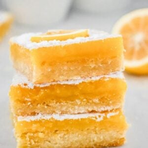 lemon-curd-slice-squares-stacked-on-white-board