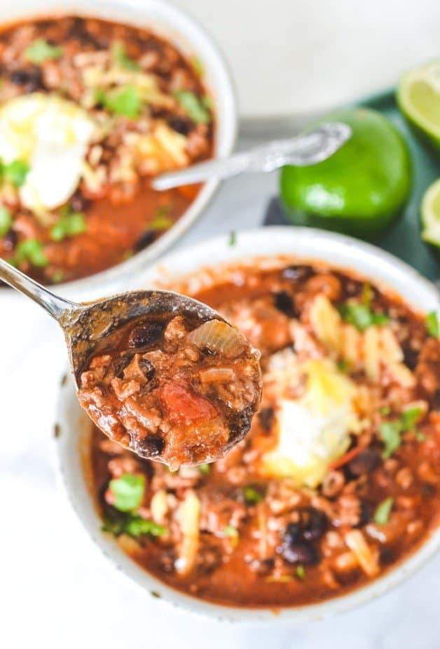 close-up-of-chilli-in-spoon-over-bowls