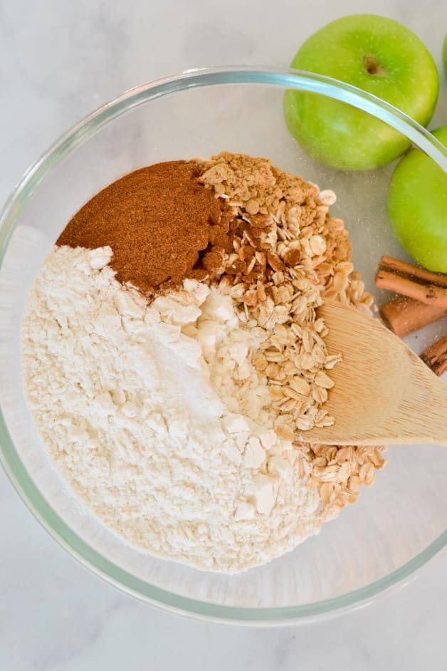 dry-ingredients-in-glass-mixing-bowl-with-wooden-spoon