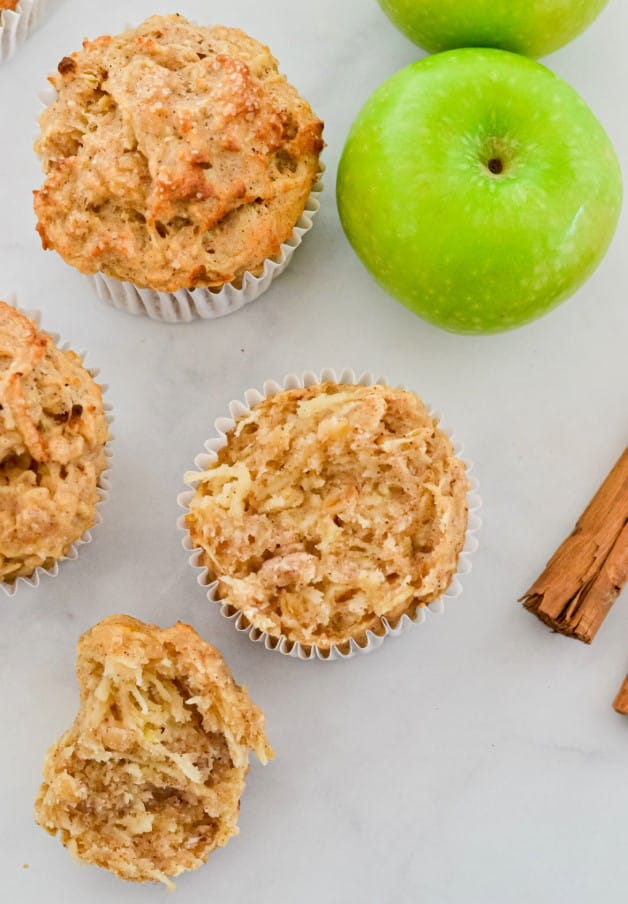 top-view-of-muffins-with-green-apples-and-cinnamon-sticks