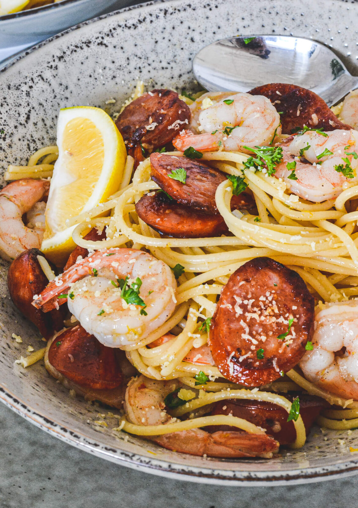 pasta-in-grey-bowl-with-prawns-and-chorizo