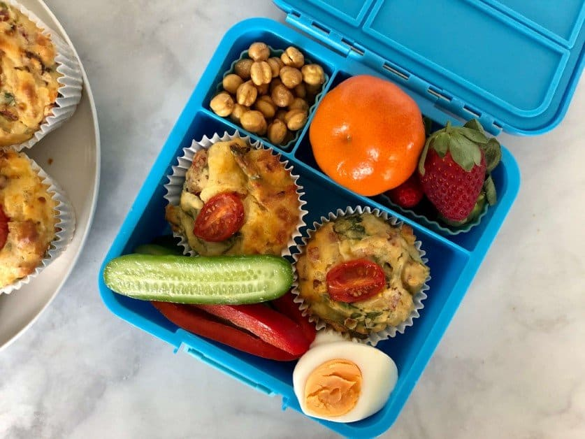 blue-lunchbox-containing-muffins-and-healthy-snacks