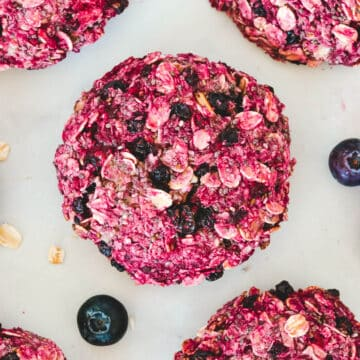 top-view-of-berry-cookies-on-white-board-with-oatmeal-flakes