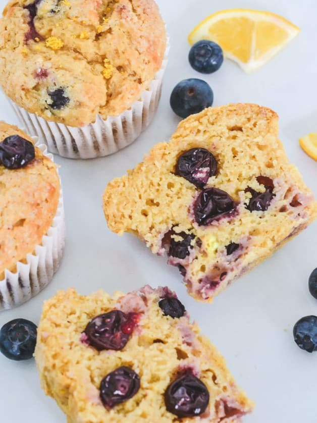 top-view-of-muffins-with-blueberries-in-centre-and-lemon-wedges