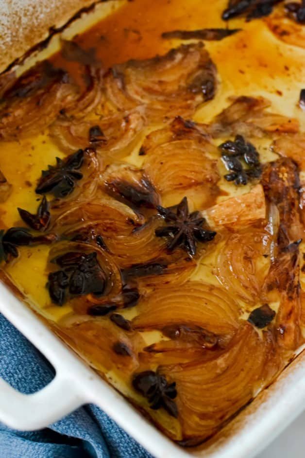 roasted onion and star anise in roasting pan
