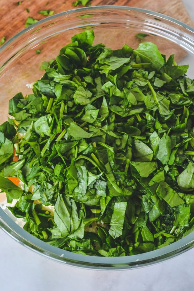 filling ingredients topped with chopped spinach