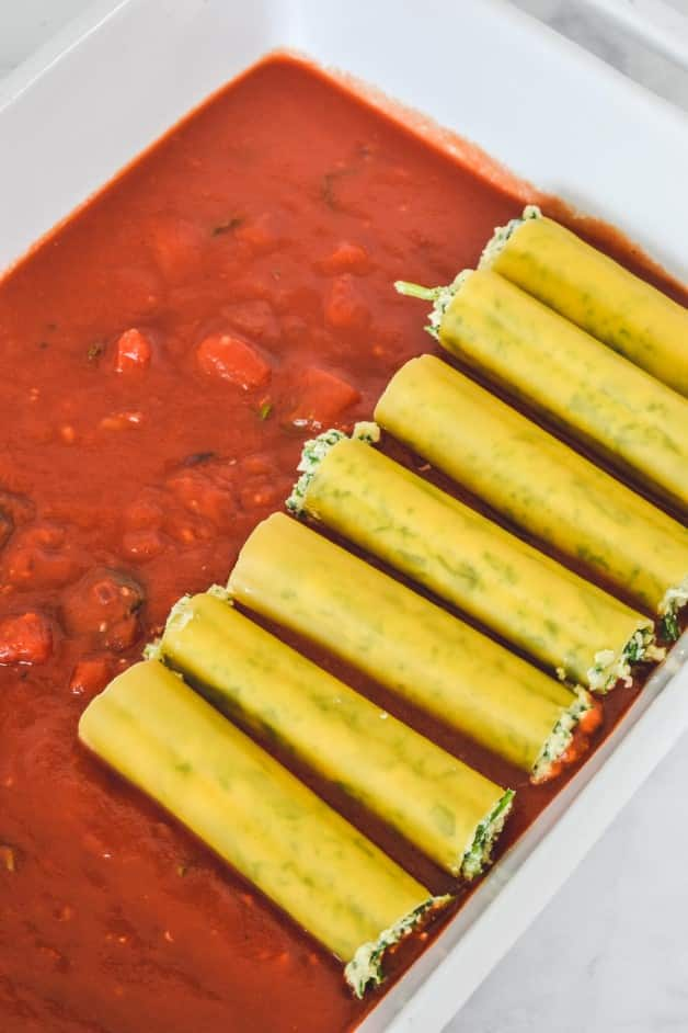 cannelloni tubes assembled over tomato sauce