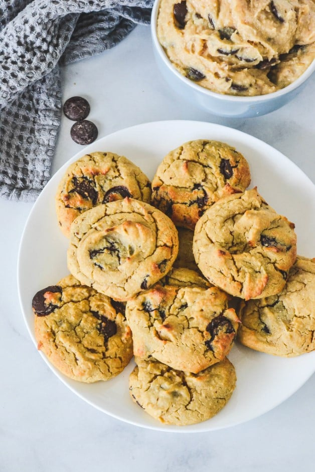 top view of cookies on a white plate with chocolate chips