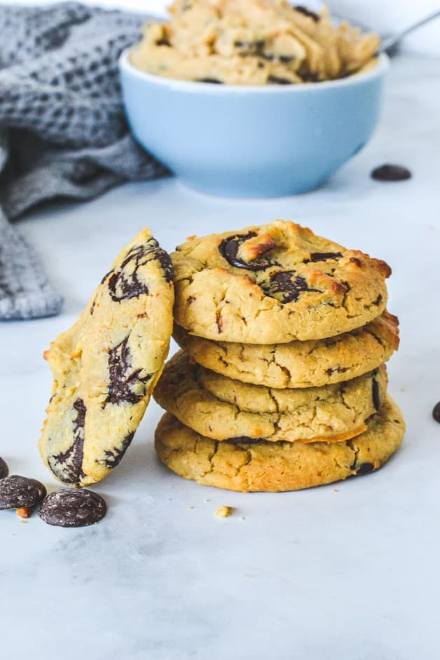 stack of cookies with chocolate chips on a white board