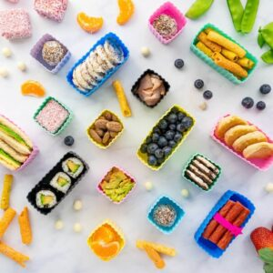 top view of coloured tubs and containers with different foods