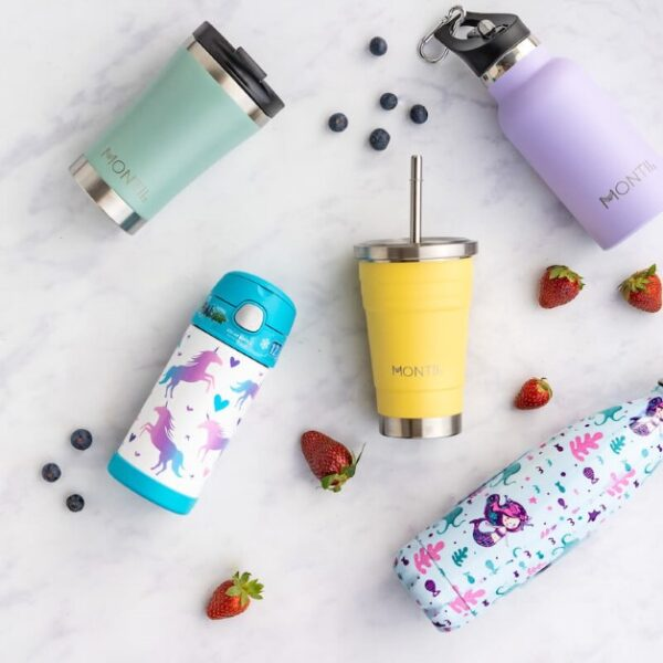top view of different stainless steel drink containers with fruit on white background