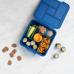 top view of a blue bento five compartment lunchbox with different foods and fruit