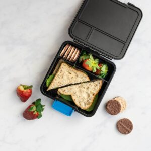 top view of a black bento three compartment lunchbox with a sandwich and food
