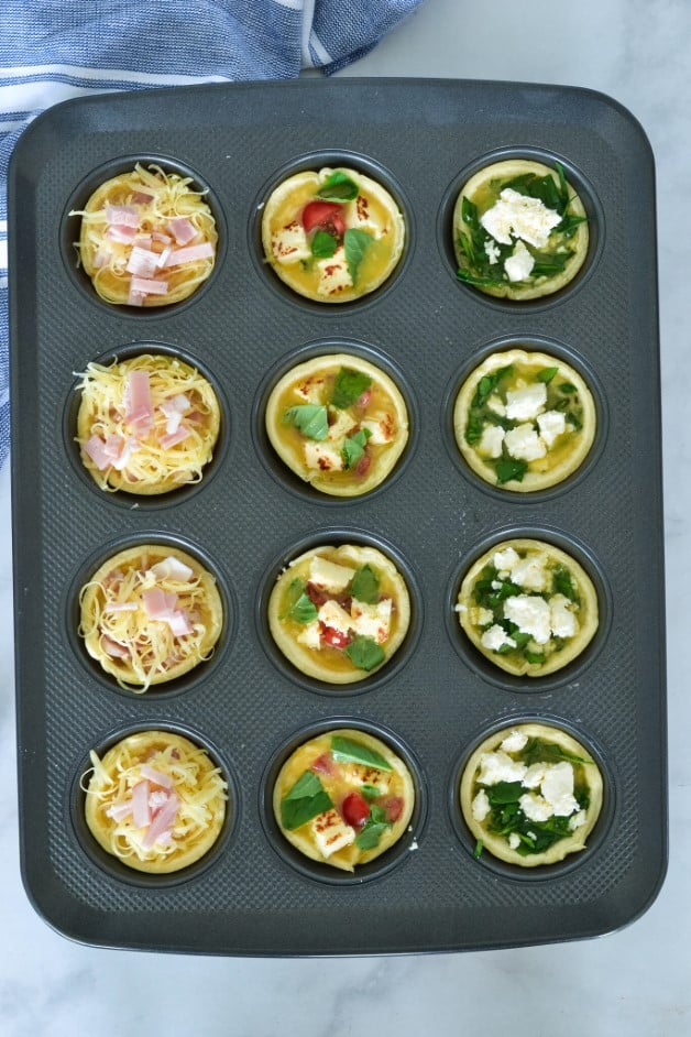 top view of quiche fillings in pastry cases