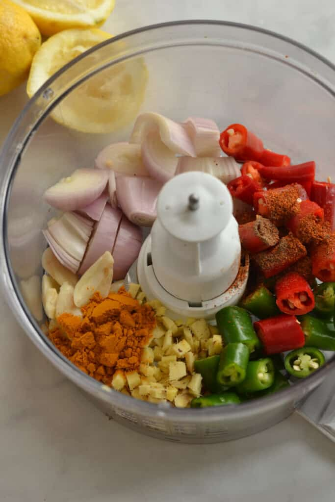 chilli and garlic and other ingredients in food processor, top view