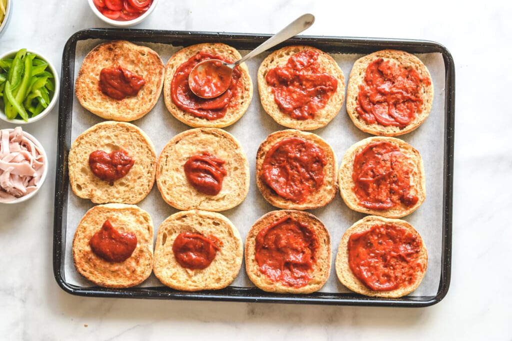 top view of muffins on baking tray with tomato paste