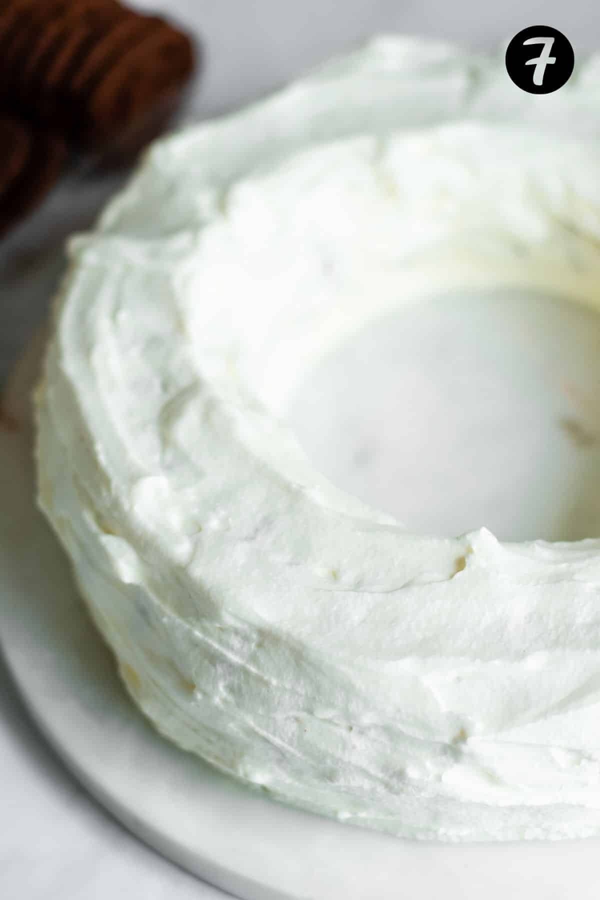 wreath shaped cake covered in whipped cream