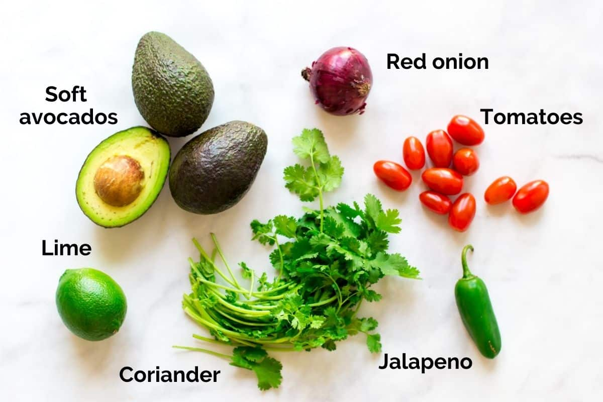 top view of individual ingredients for guacamole laid out on a table