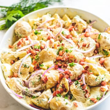 front view of finished potato salad in white bowl