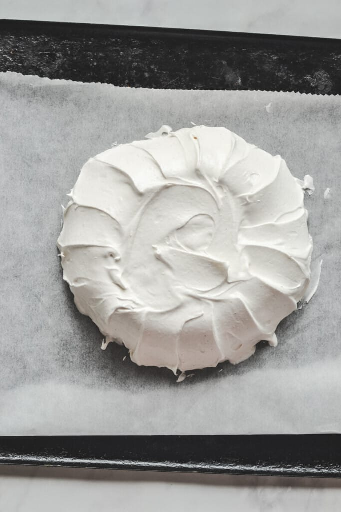 top view of meringue shaped into a circle on a baking tray