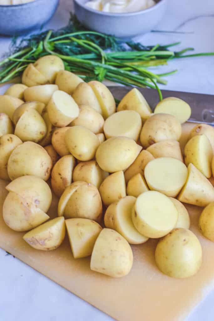 raw potatoes sliced on board