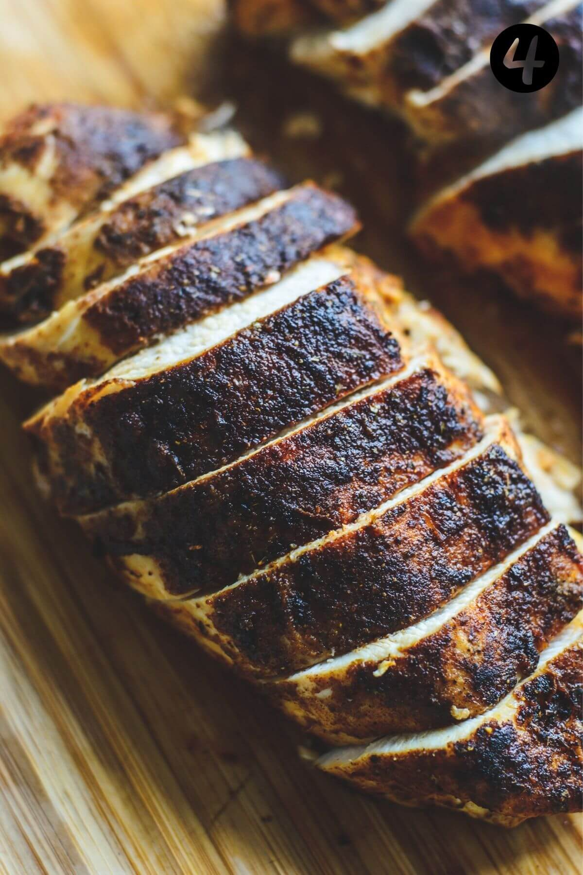 close up of sliced chicken breast on a wooden board