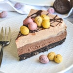 close up of a slice of chocolate cheesecake topped with Easter eggs