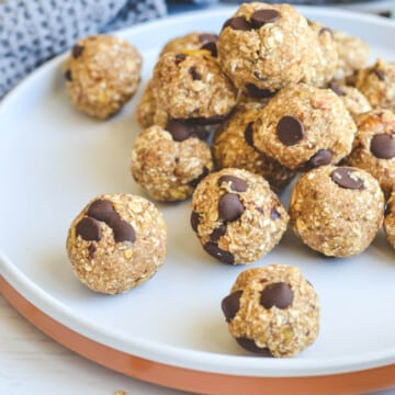 bliss balls with chocolate chips on a white plate