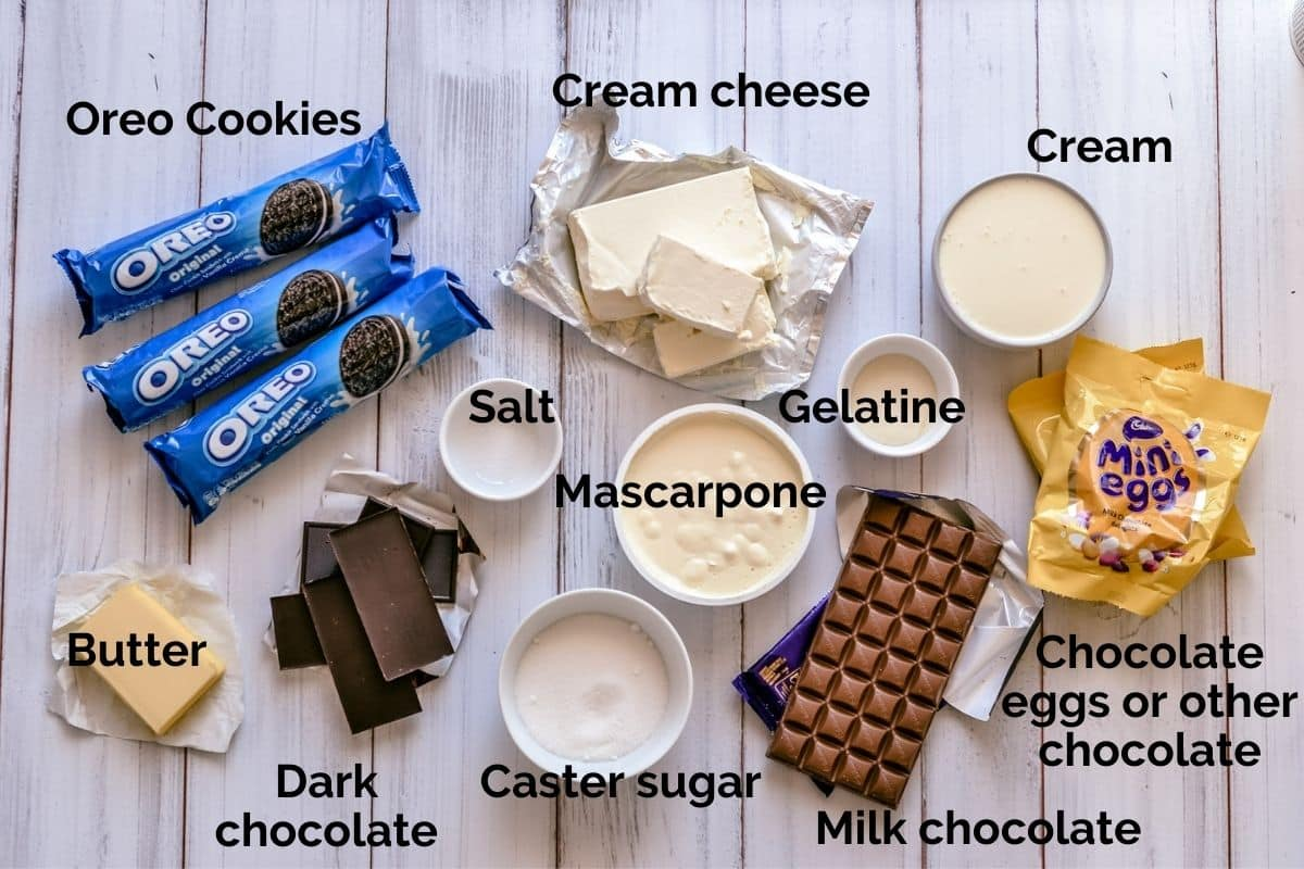 top view of all ingredients for chocolate cheesecake, spread over a table