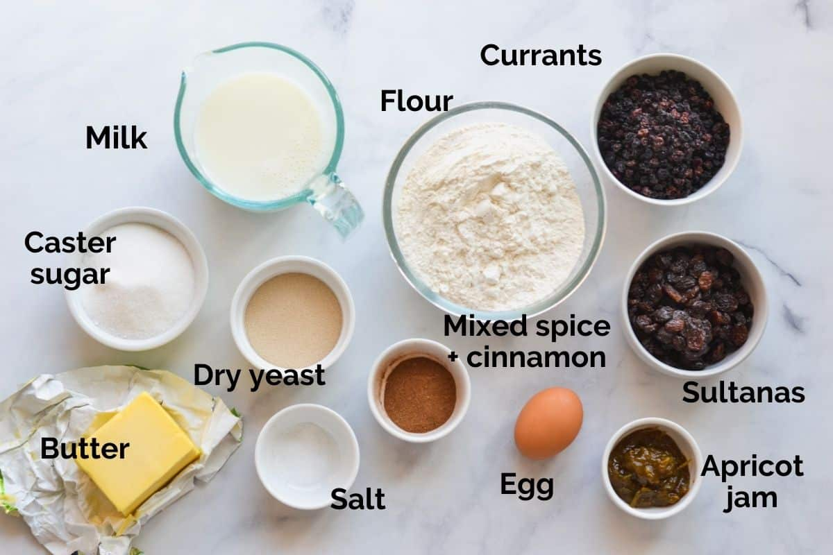 all ingredients for hot cross buns laid out on a table