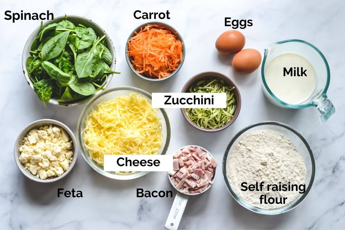 all ingredients for vegetable muffins laid out on a table