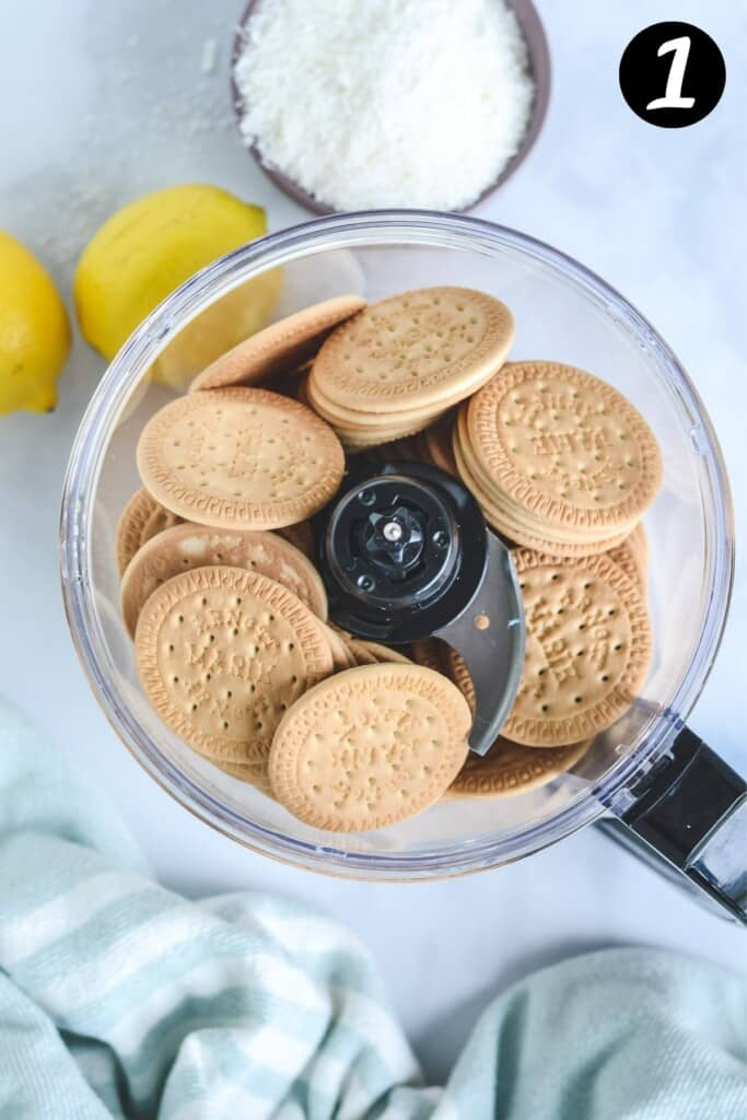 top view of a food processor filled with Marie biscuits