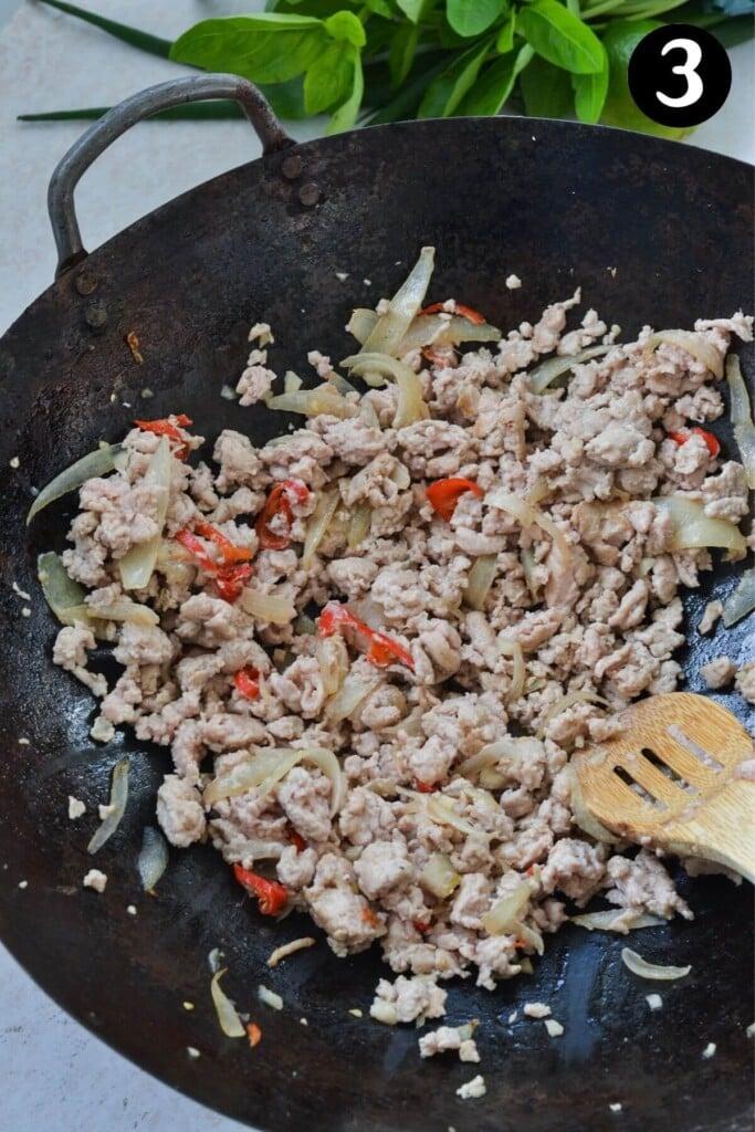 chicken browning in a wok