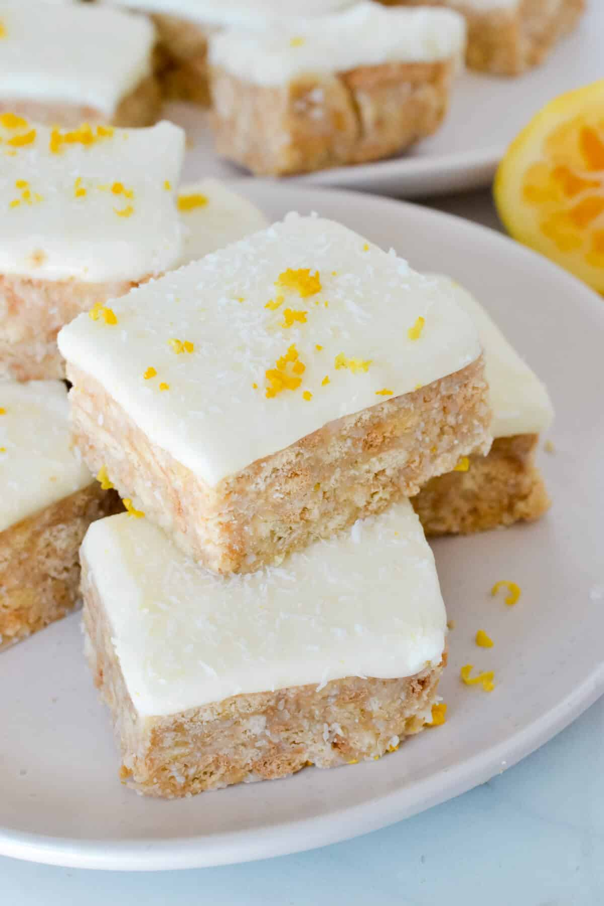 pieces of lemon slice topped with zest on a white plate