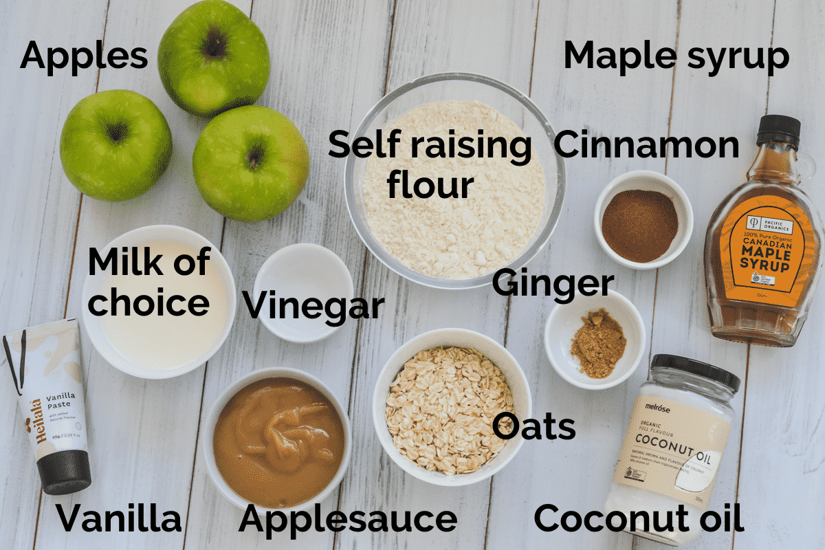 all ingredients for apple vegan muffins laid out on a white table