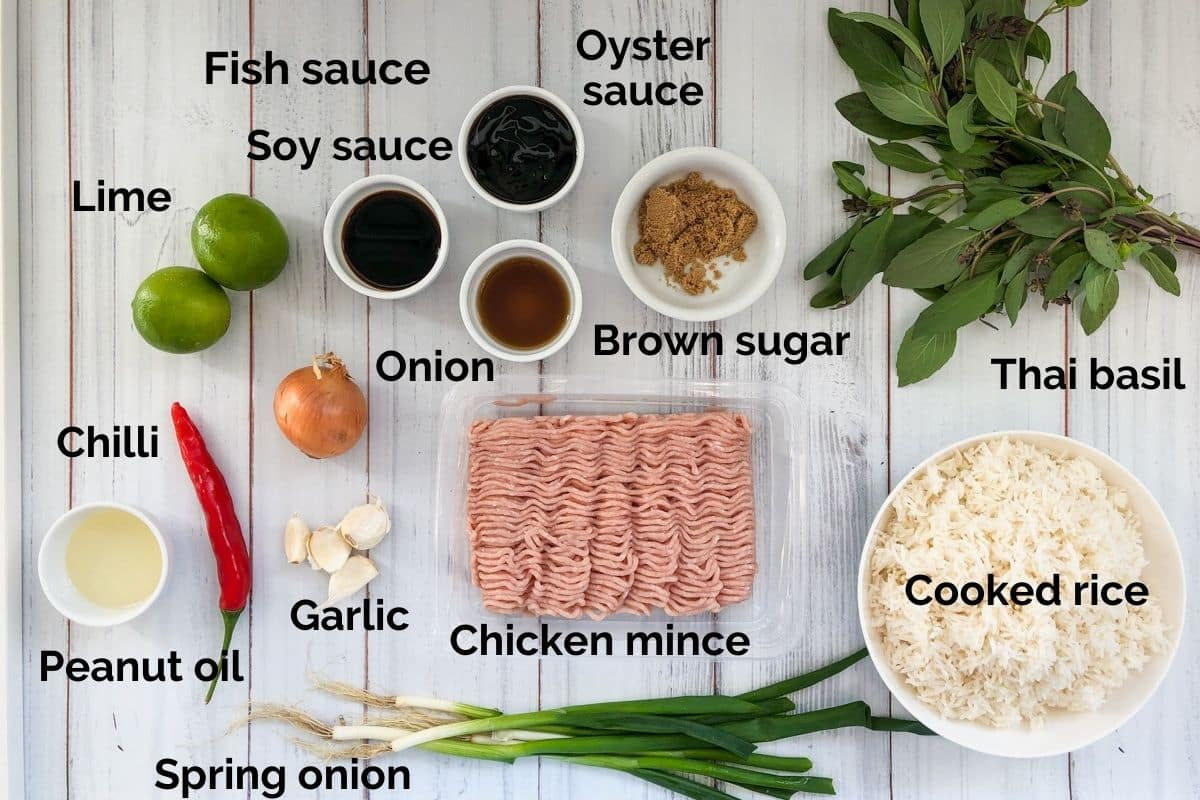 all ingredients for thai basil fried rice laid out on a white table