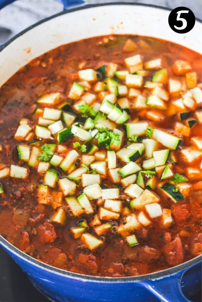 diced zucchini added to vegetable tortellini soup