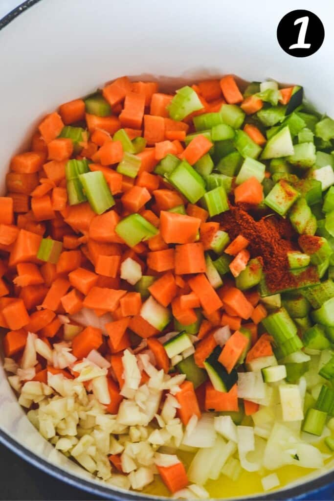 chopped vegetables in a large white pot