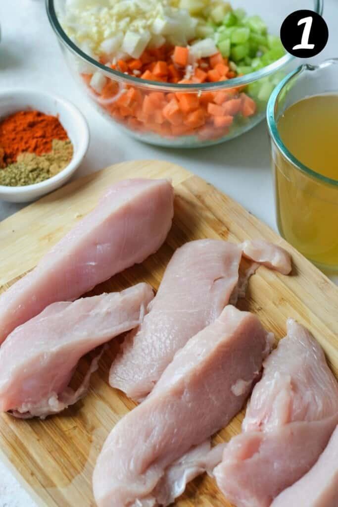 sliced chicken breast on a wooden board