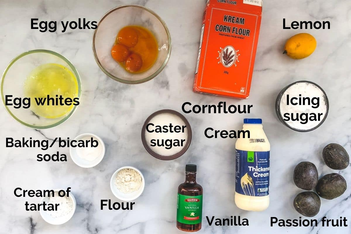all ingredients for sponge cake laid out on a table