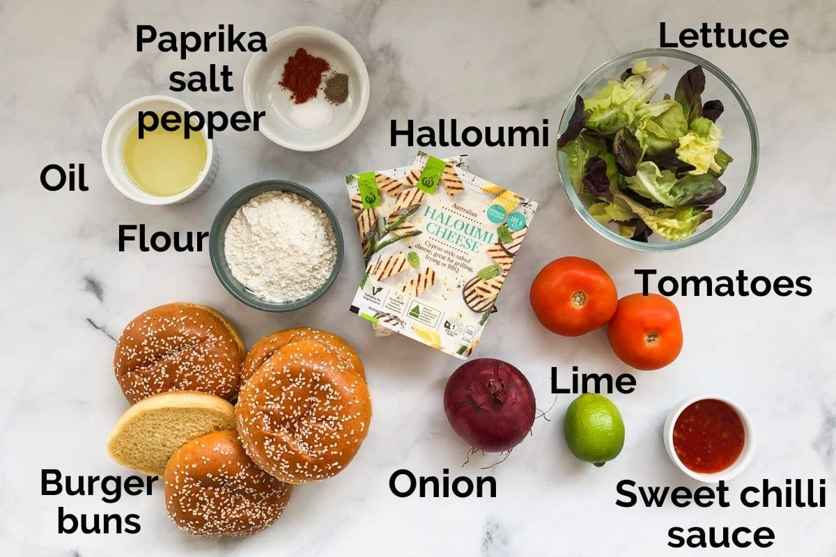 all ingredients for halloumi burgers laid out on a table