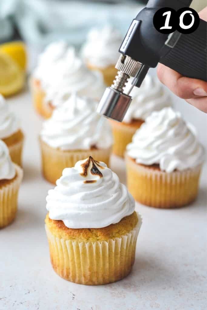 a blow torch toasting meringue on a cupcake