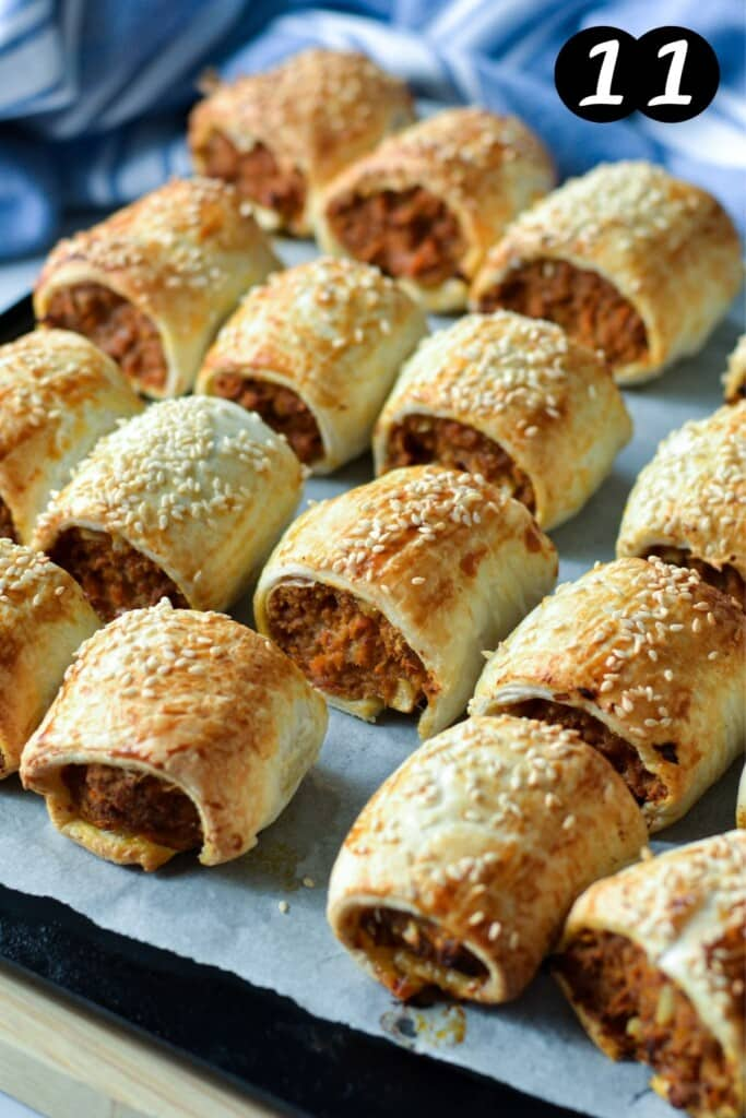 finished pork sausage rolls on a baking tray